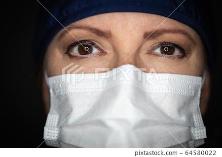 Female Doctor or Nurse Wearing Medical Face Mask 64580022