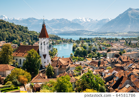 Thun cityscape with Alps mountain and lake in Switzerland 64581786