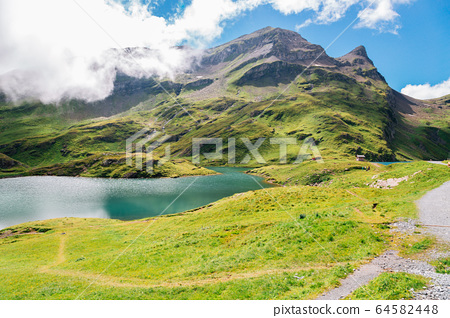 Bachalpsee lake and Swiss Alps mountain Grindelwald First in Switzerland 64582448