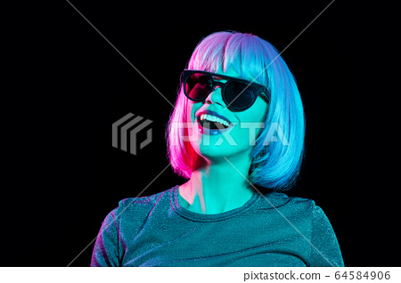 happy woman in pink wig and black sunglasses 64584906