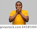 scared african american man covering his mouth 64585494