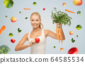 happy smiling young woman with heart and carrots 64585534