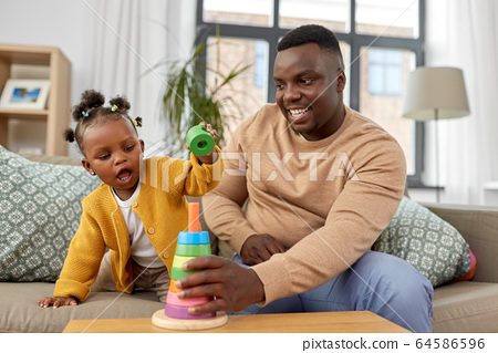 african family playing with baby daughter at home 64586596