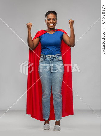 happy african american woman in red superhero cape 64588377