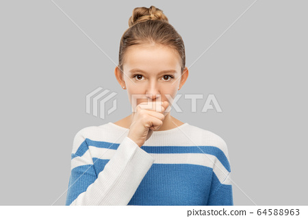 sick coughing teenage girl in pullover 64588963