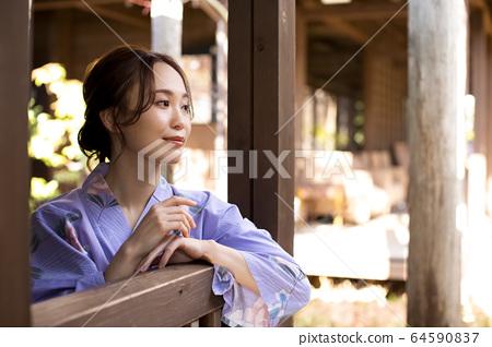 Woman enjoying a hot spring trip 64590837