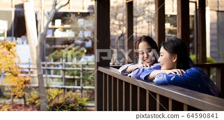 Women and friends enjoying a hot spring trip 64590841