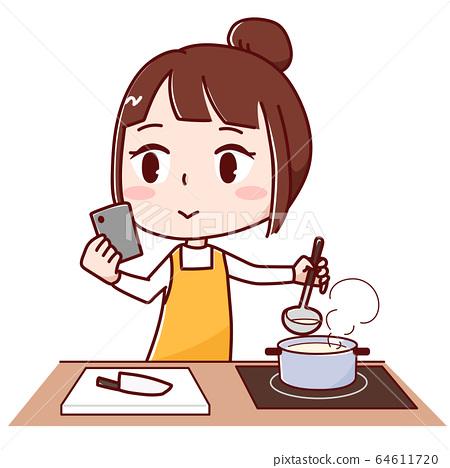 一邊看智能手機上的食譜一邊做飯的女人 64611720