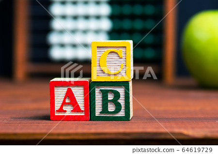 Alphabet and education abstract in front of the 64619729