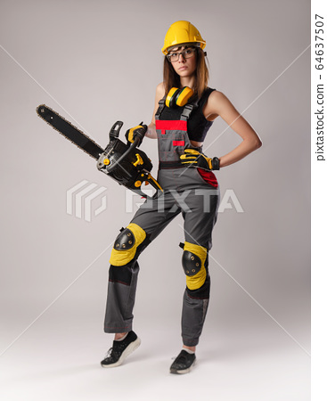 Girl in overalls with a chainsaw in white background 64637507