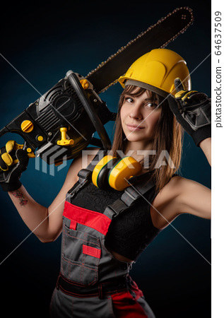 Girl in overalls with a chainsaw 64637509