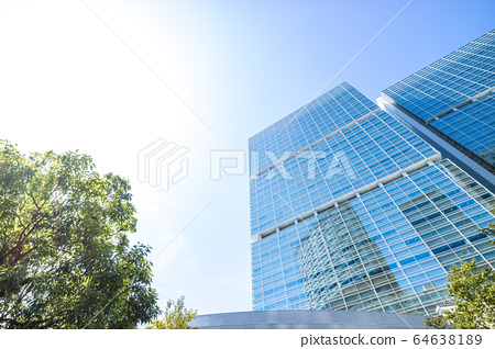 Landscape of the office town looking up at a skyscraper 64638189