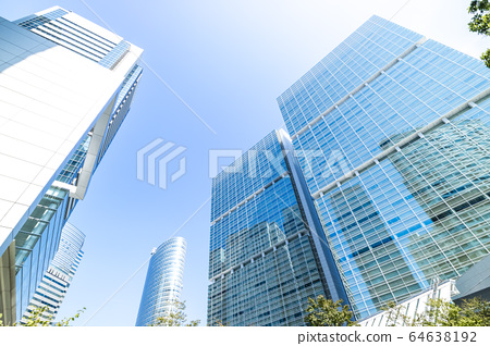 Landscape of the office town looking up at a skyscraper 64638192