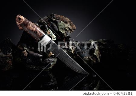 Hunter combat hand made knife and broken stones. 64641281