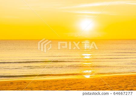 Beautiful tropical nature beach sea ocean at sunset or sunrise 64667277