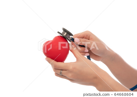 Stethoscope with heart in doctor hands isolated on white background, close-up, free from copy space, healthcare concept. 64668604