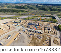 Aerial view of new construction site with crane and building materials.  64678882