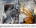 Bulldozer loader uploading concrete debris into 64701163