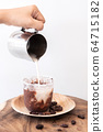 Ice chocolate drink with foam and cacao beans.  64715182