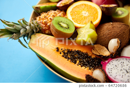 plate of exotic fruits on blue background 64720686