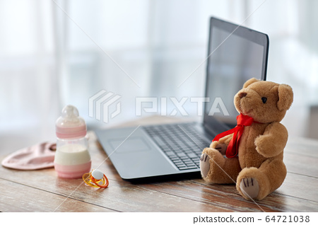 baby milk formula, laptop, soother and teddy bear 64721038