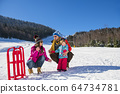 Happy Family In Snow Riding On Sledge. 64734781