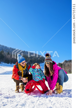 Happy Family In Snow Riding On Sledge. 64735311