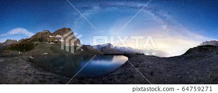 Matterhorn mountain and blue lake under starry sky. 64759271