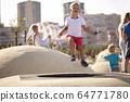 Boy jumping on trampoline 64771780