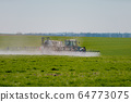 Tractor Spraying Herbicides on Field Agriculture 64773075