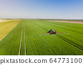 Agriculture Tractor Working in Field 64773100