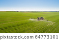 Tractor Spraying Herbicides on Field Agriculture 64773101