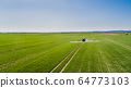 Tractor Spraying Herbicides on Field Agriculture 64773103