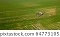 Agriculture Tractor Working in Field 64773105