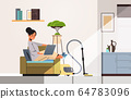 woman freelancer using laptop working at home during coronavirus quarantine self-isolation freelance 64783096