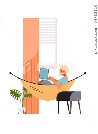 woman freelancer using laptop working at home during coronavirus quarantine self-isolation freelance 64783110
