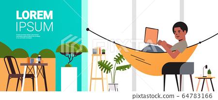 man freelancer using laptop working at home during coronavirus quarantine self-isolation freelance 64783166