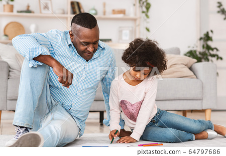 Stay home, be creative. African American family of grandfather and granddaughter drawing on floor at home 64797686