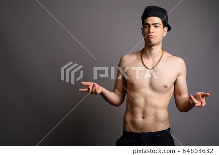 Young handsome man shirtless against gray background 64803632