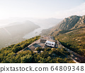 Caravan at the top of Mount Lovchen in Montenegro. A house on wheels near a mountain cliff. Trailer with panoramic views of Kotor Bay. 64809348