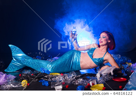 Sea plastic pollution concept. Mermaid in the ocean. Plastic is everywhere. Environmental protection. 64816122