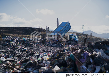 Garbage truck unloading waste on landfill, environmental concept. 64846232