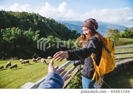 couple asians travel nature in the holiday. Hold hands running happy enjoy nature on the mountain 64861589