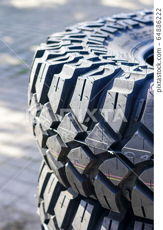 closeup view of new mud and terrain tire tread 64886222