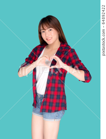 Beautiful happy young asian woman wear travel summer gesture heart shape with hand 64892422
