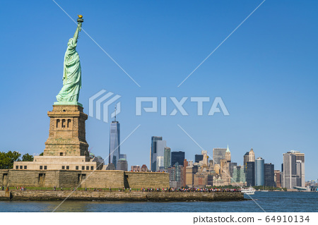 The statue of Liberty  with blue sky background. 64910134