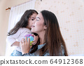 Joyful cute little girl holding small color ball 64912368