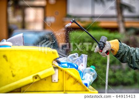 Spraying trash cans due coronavirus Covid-19 64915413