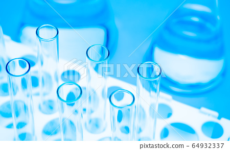 Close-up of the test tube on a blue background. 64932337