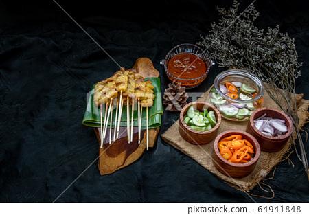Pork satay eating with your peanut sauce and 64941848